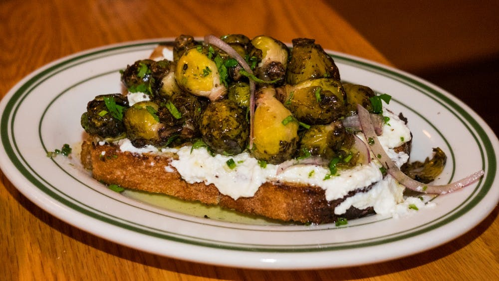 Toast laden with ricotta cheese and brussels sprout ceviche.jpg
