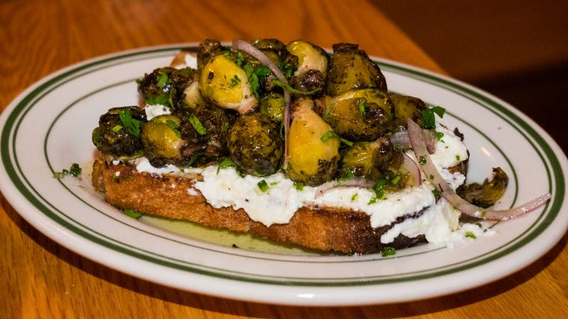 toast with ricotta cheese and brussels sprout ceviche