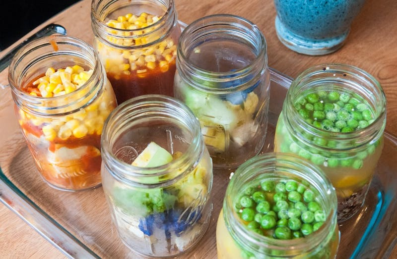 mason jars with fruit and vegetables
