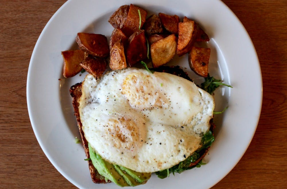 avocado toast with eggs and potatoes