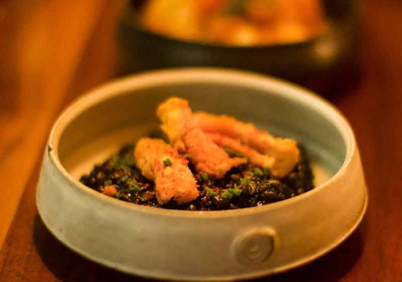 calamari on cheesy black rice