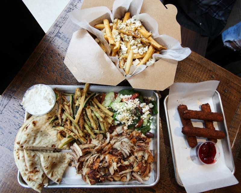 gyro tray, feta sticks with jam, and french fries