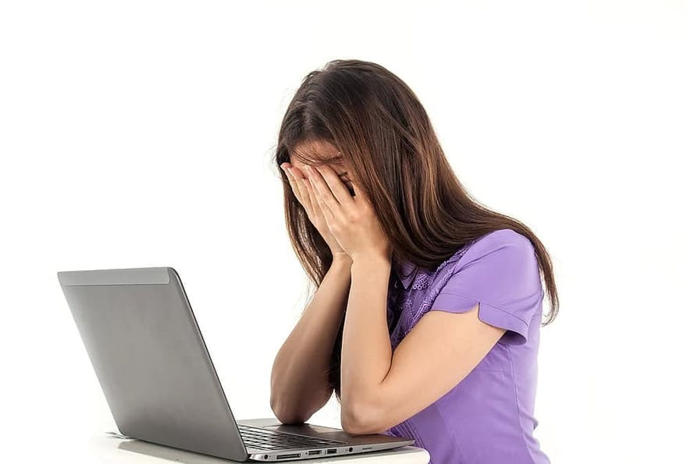 girl-computer-notebook-white-background-emotions-people-work-fatigue