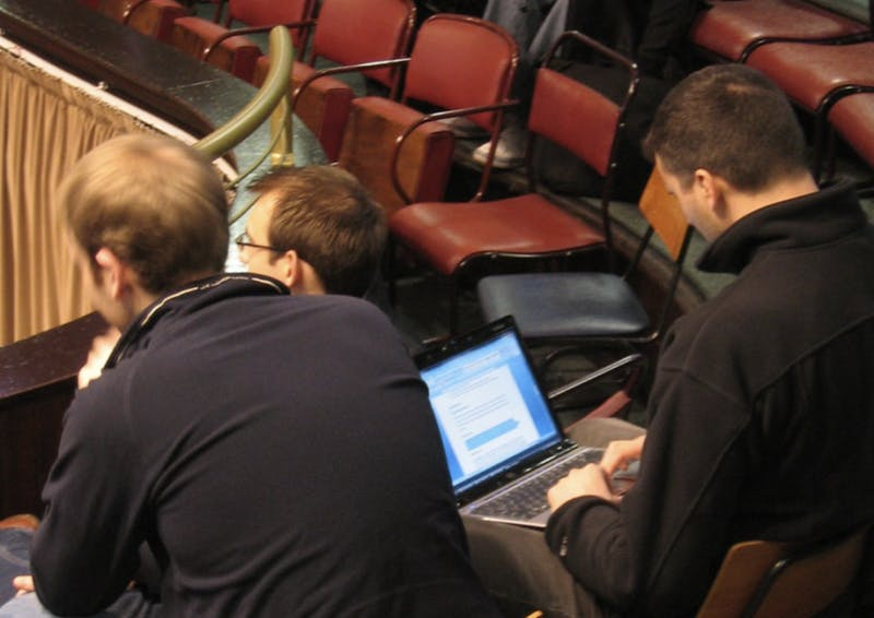 Busy and Elite Pre-Professional Student Uses Slack During Lecture