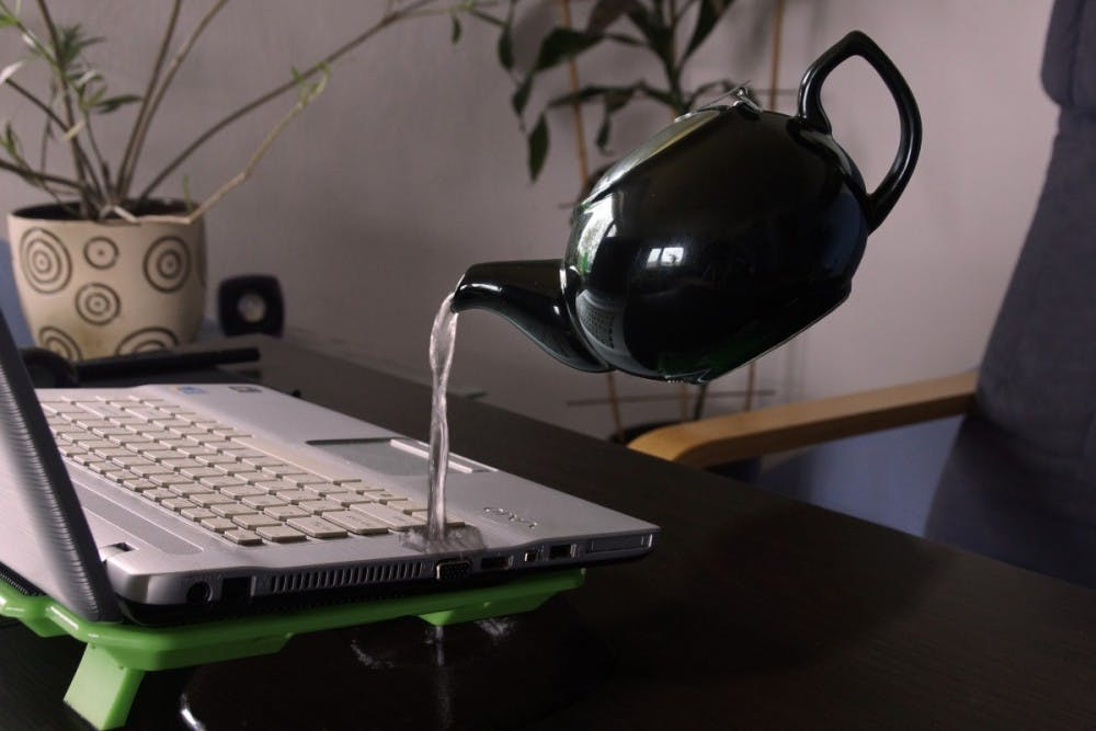 computer_kettle_laptop_pouring_water_water_damage_royalty_free_images-1033953
