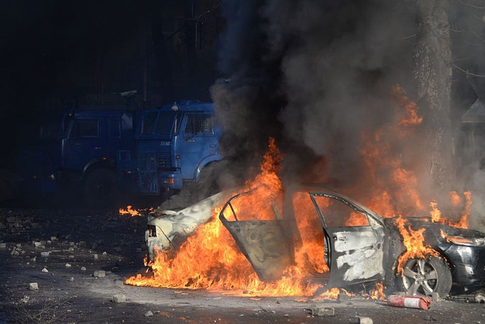 car_put_on_fire_in_the_barricade_line_as_clashes_in_kyiv_ukraine_events_of_february_18_2014