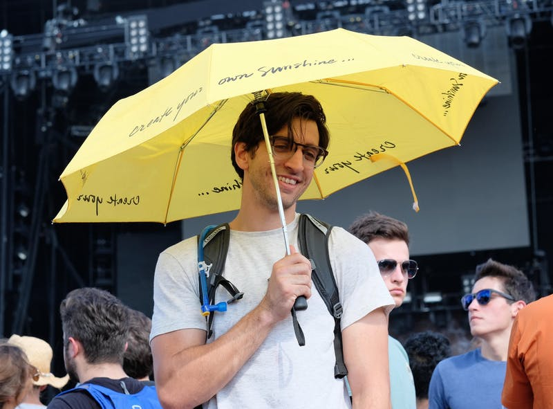Get Over Yourself: Student Really Using Umbrella in Scanty Drizzle