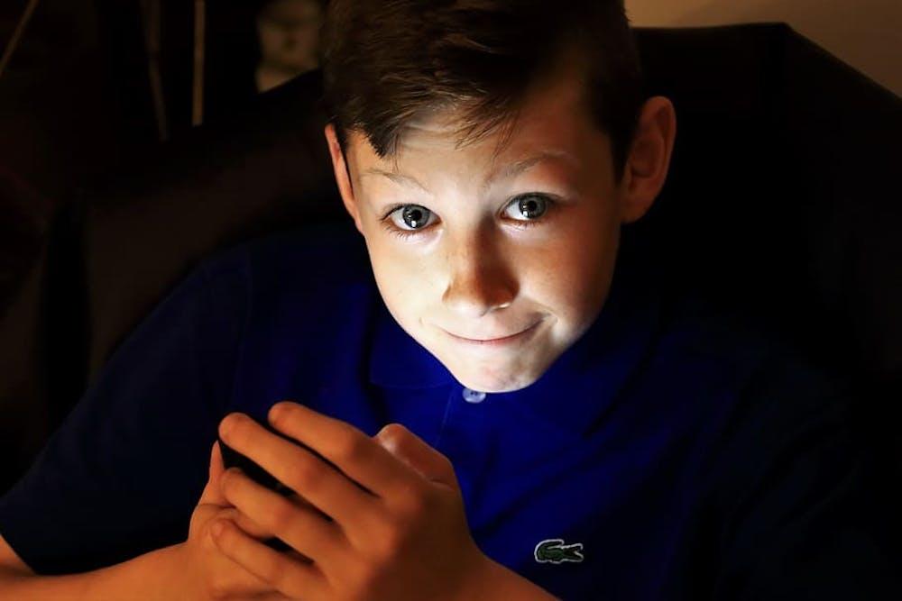 boy-mobile-phone-lightt-smirk
