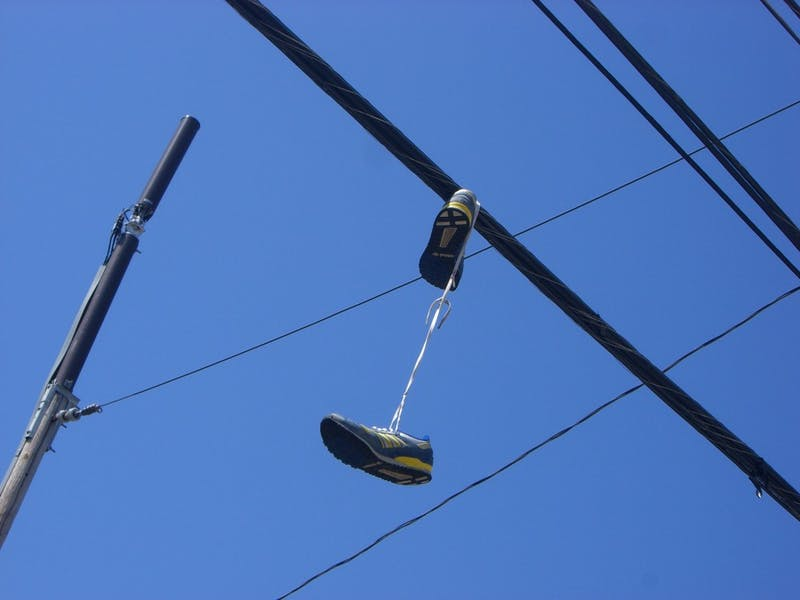 Sneakers Among The Wires: Modern Art Piece Or Drug Dealer Marking?