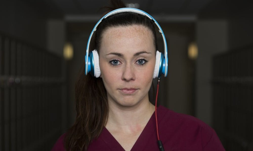 female-with-headphones-student_800
