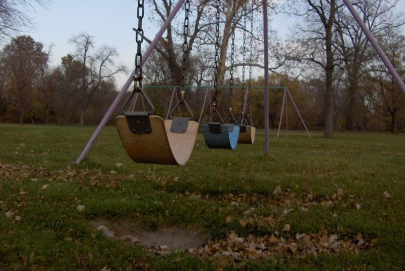 Caps Installs an Elementary School Swing Set on College Green for Students to Brood On
