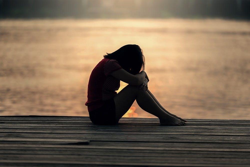 sad-girl-evening-jetty-morning-sitting-one-docks-1822702