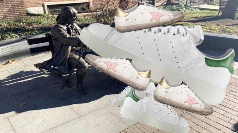 Students Install Giant White Sneaker on Ben Franklin Bench to Represent White Sneakers at Penn