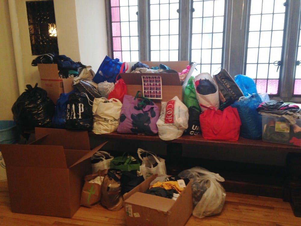In collaboration with 12 other groups, Penn's Fiji fraternity collected 917 total articles of clothing during their clothes drive on Friday.