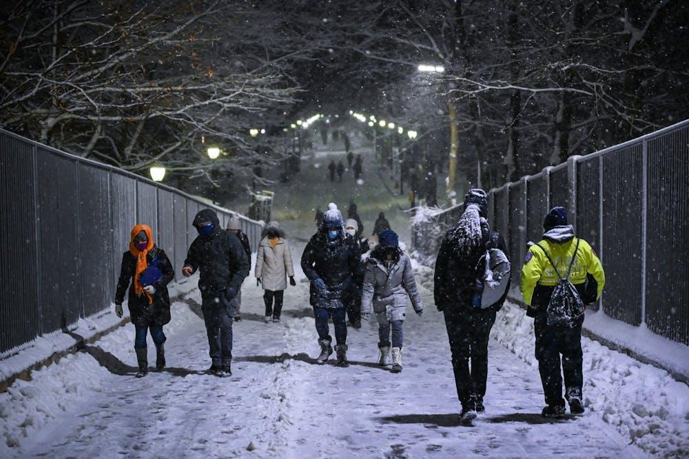 02-01-21-noreaster-orlena-snow-locust-walk-bridge-night-campus