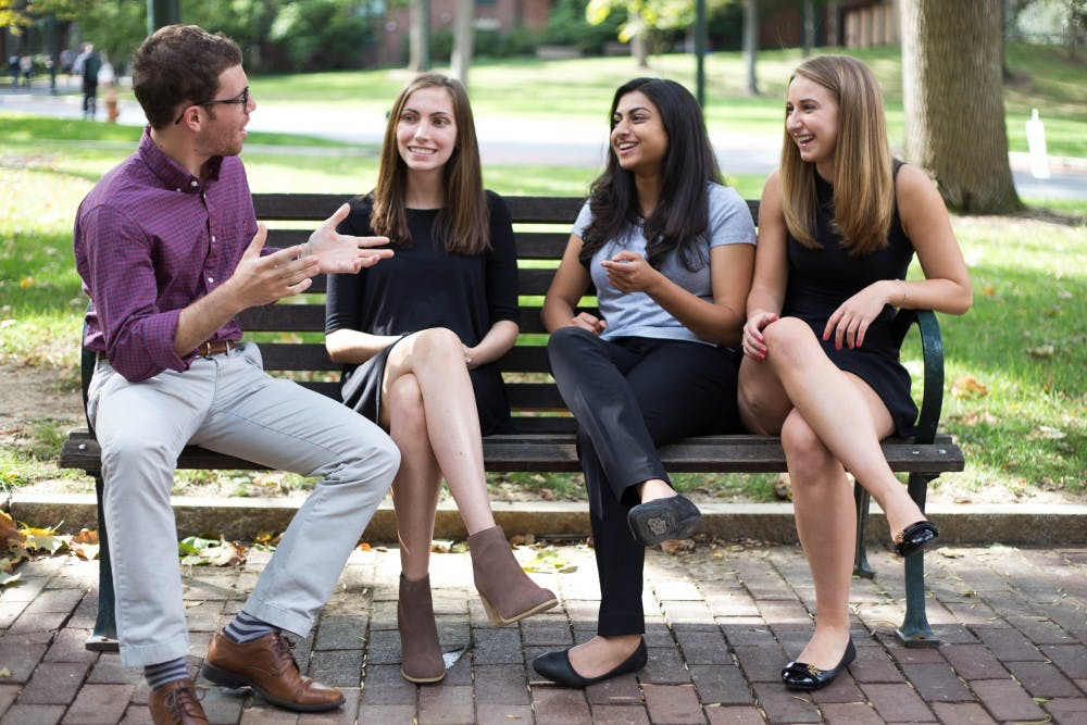 The board members of the newly established Penn Bioethics Society, Perry Goffner, Susannah Rogers, Ruchita Pendse and Jessica Davis, enjoy having philosophical discussions about bioethics on College Green.