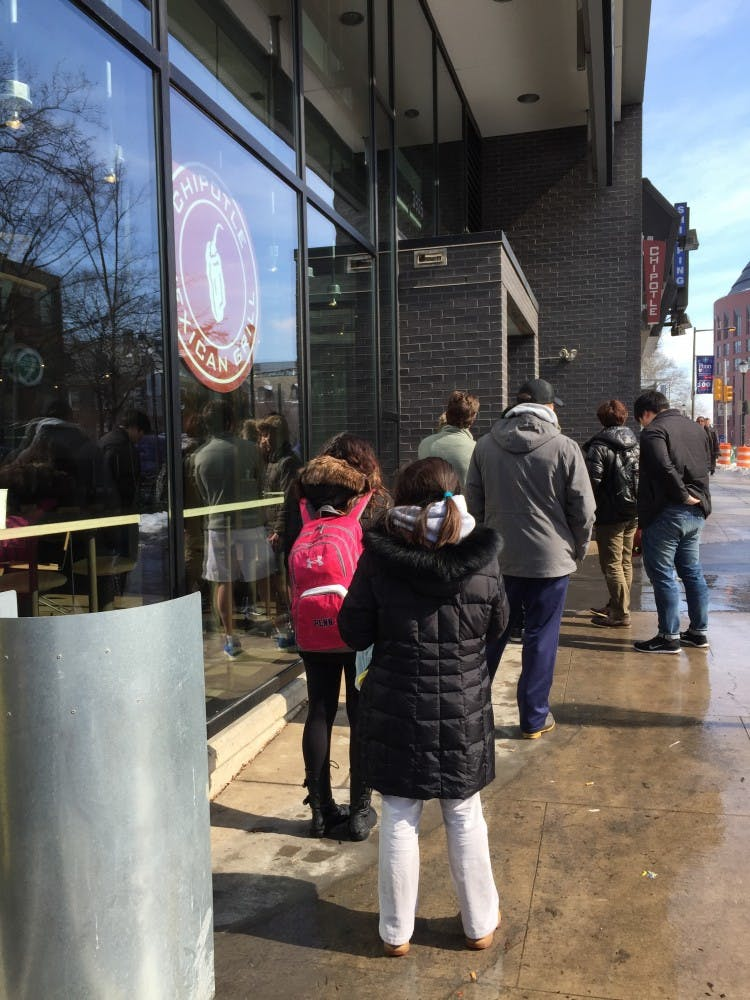 People lined up outside Chipotle shortly before 1 p.m., when it said it would open.