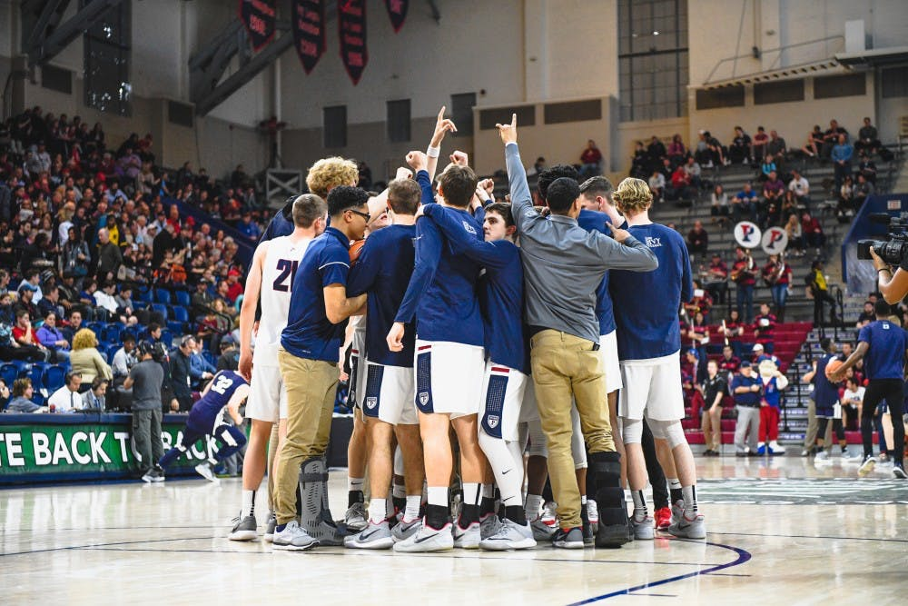 penn-mbb-mens-basketball-vs-yale-ivy-tournament-huddle