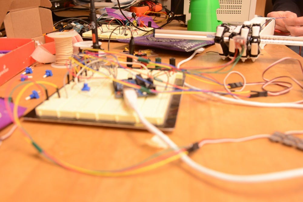 The circuit board detects pressure on sensor chips that are used to convey the sense of touch to a user.