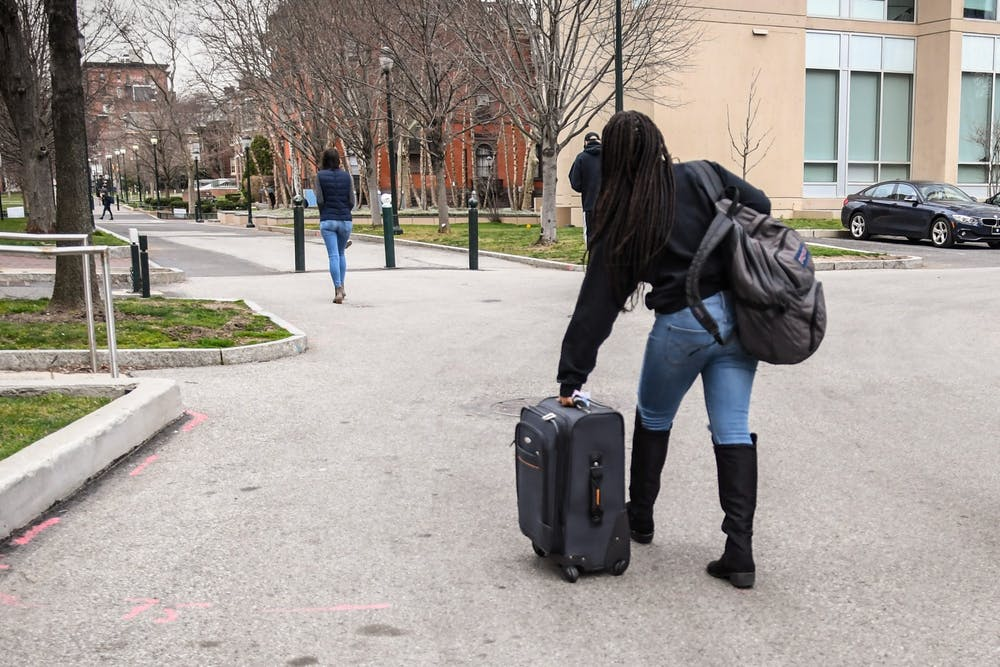coronavirus-move-out-international-students-abroad-travel-suitcase