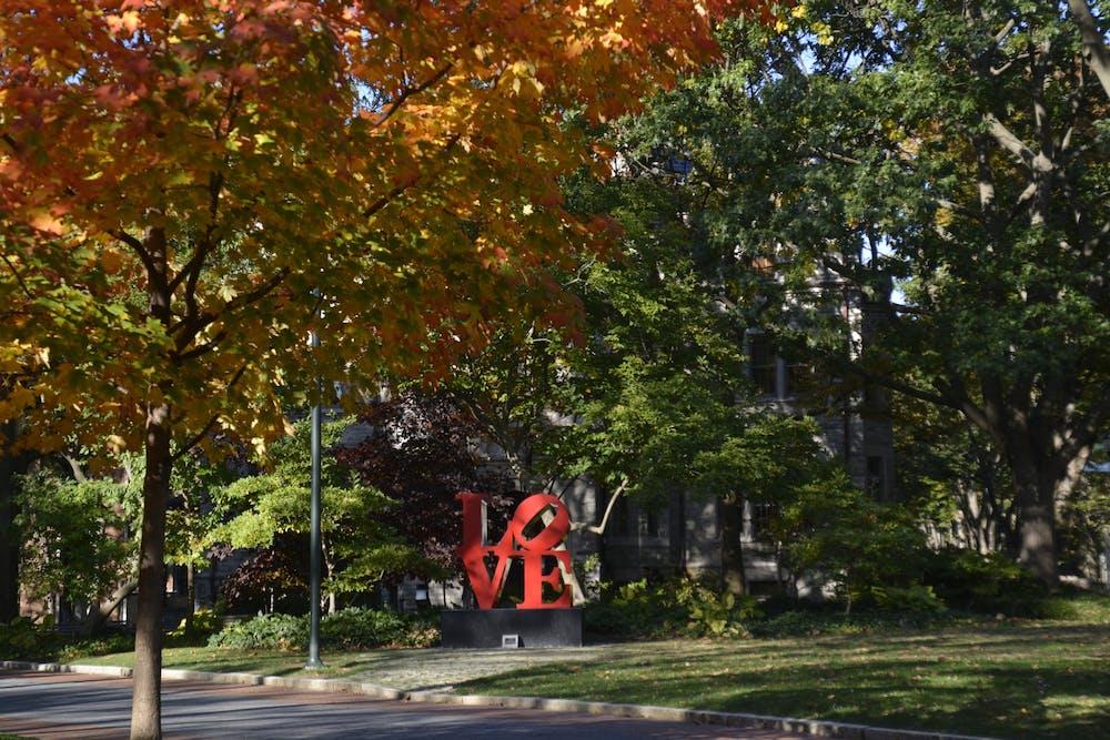 love-statue-locust-walk-fall-leaves