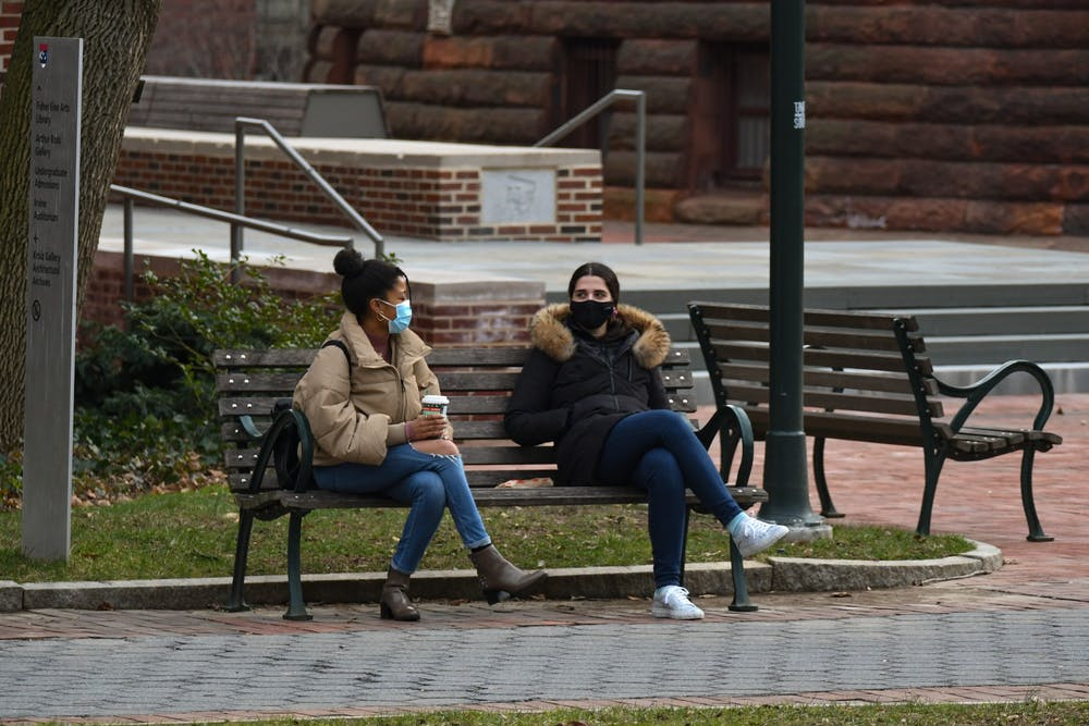 socially-distant-wearing-masks-bench-covid-19-pandemic-spring-coffee-friends-colleagues-campus-locust