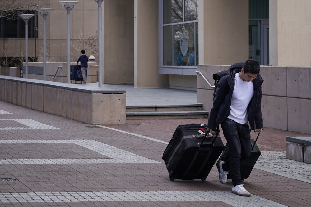 suitcase-travel-move-out-move-in-thanksgiving-winter-break