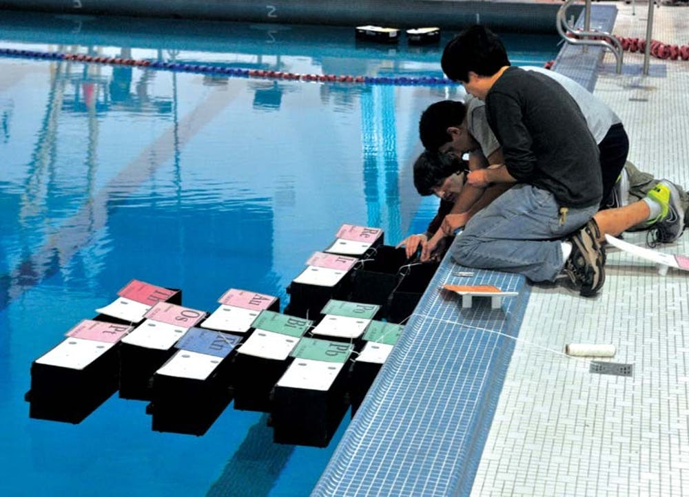 Demonstration of robotic boats at Pottruck's pool.