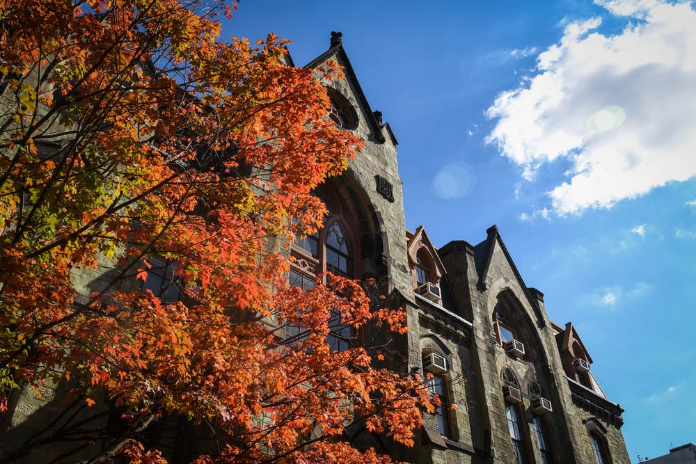 college-hall-fall-campus-leaves
