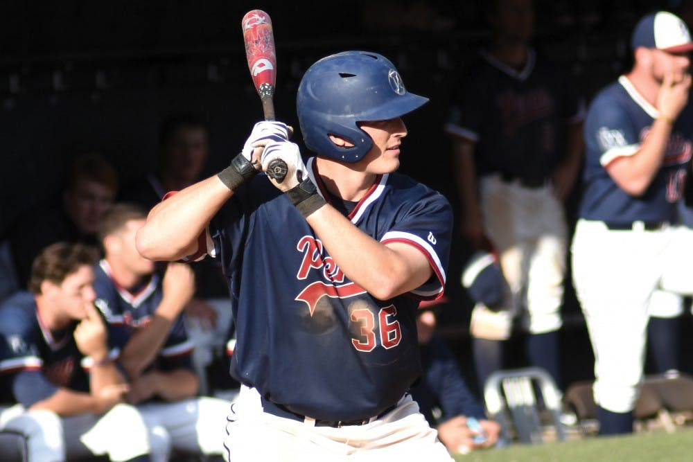 Senior catcher Austin Bossart hit a home run in the first game of Penn's series against Columbia on Saturday, sparking the Quakers to a key 4-3 win.