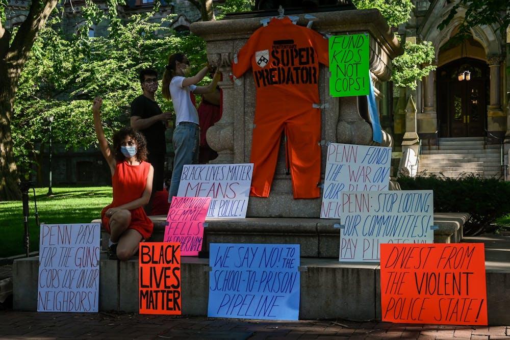 06-13-20-penn-protest-zoe-sturges-benjamin-franklin-defund-police-signs