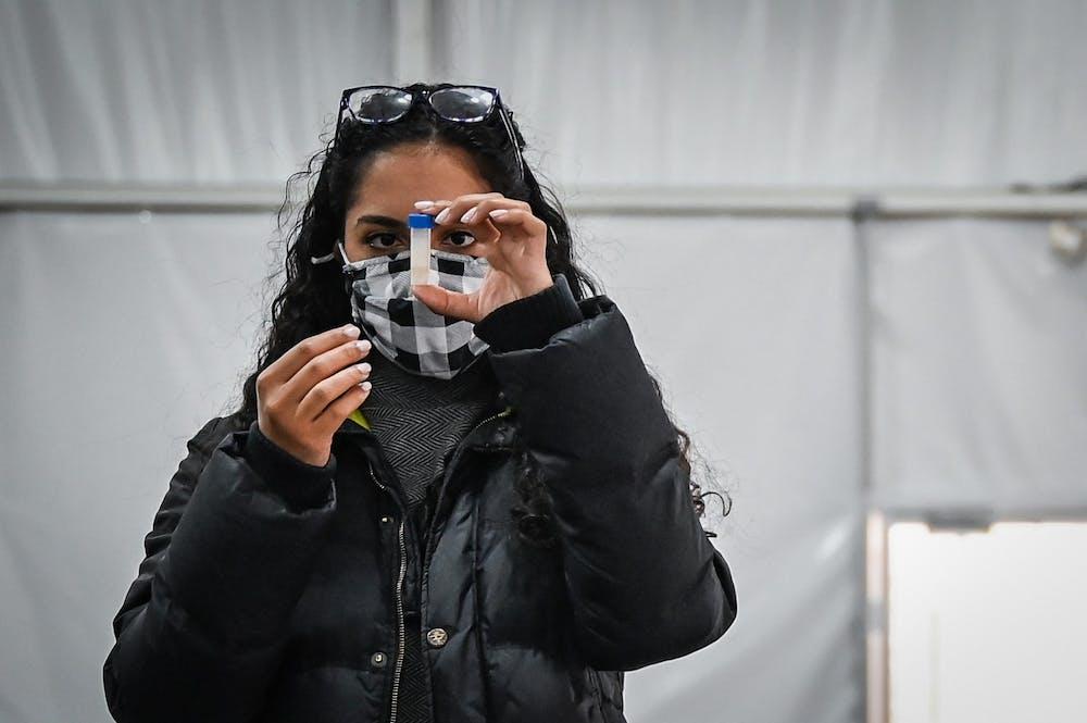 01-19-21-penn-covid-19-testing-sites-dubois-rodin-high-rise-field-tent-sarah-ramadan-kylie-cooper