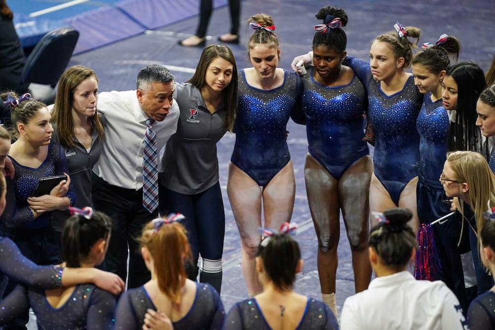 gymnastics-team-and-coach-john-ceralde