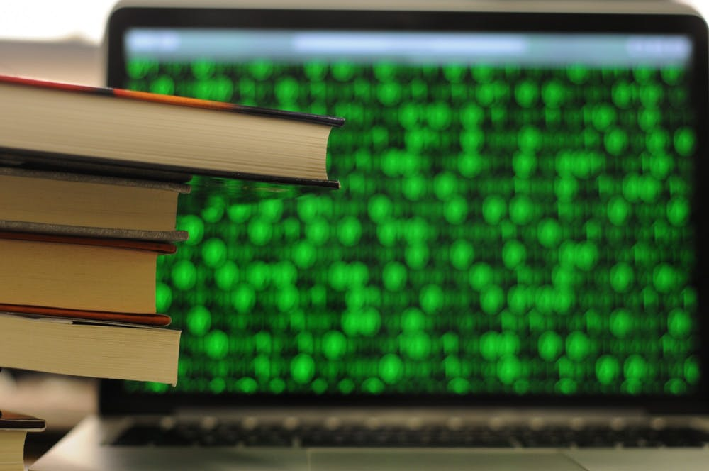 research-books-coding-laptop