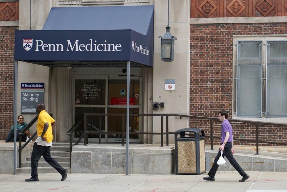 penn-medicine-maloney-building-people-walking-penn-campus