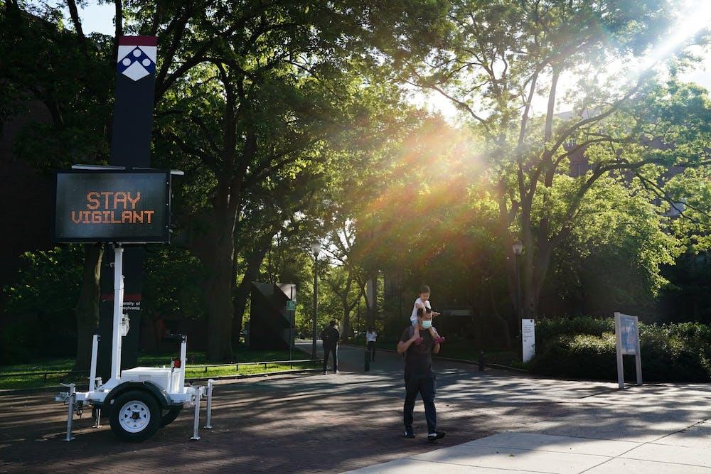 coronavirus-sign-stay-vigilant-second-wave-campus-locust-walk