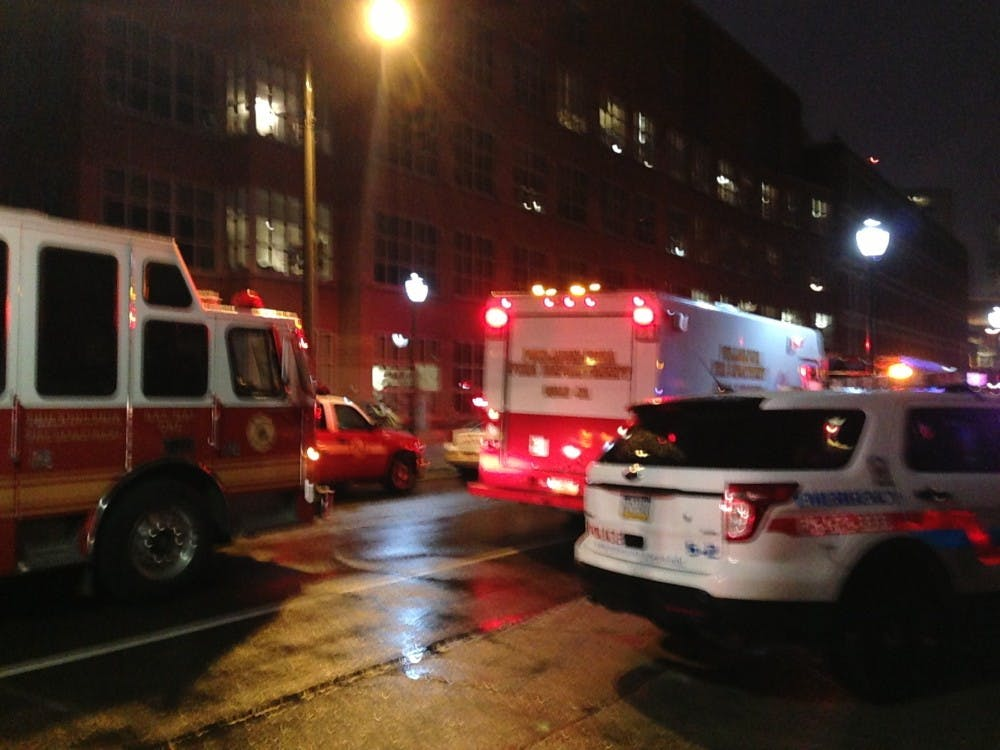 Emergency vehicles park outside Vagelos Labs, where a Haz Mat incident occured this morning.