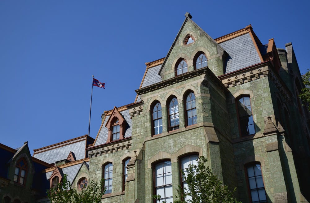 college-hall-penn-flag-campus
