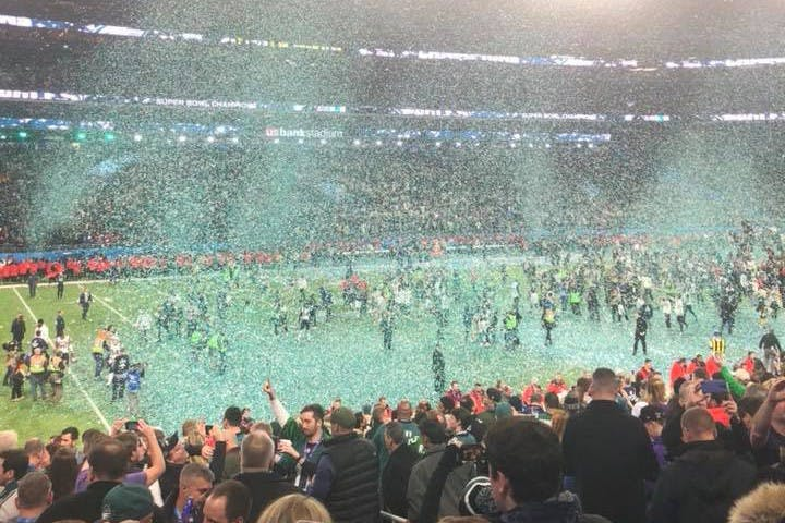 Confetti on the field after the Eagles' win