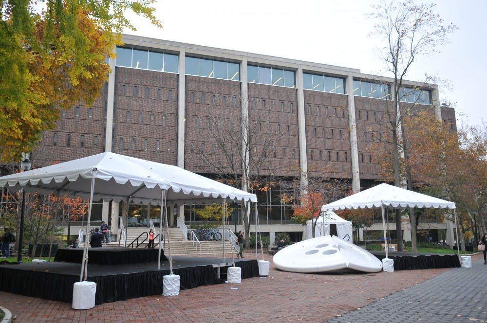 Tents were set up in front of Van Pelt library in preparation for Homecoming Weekend