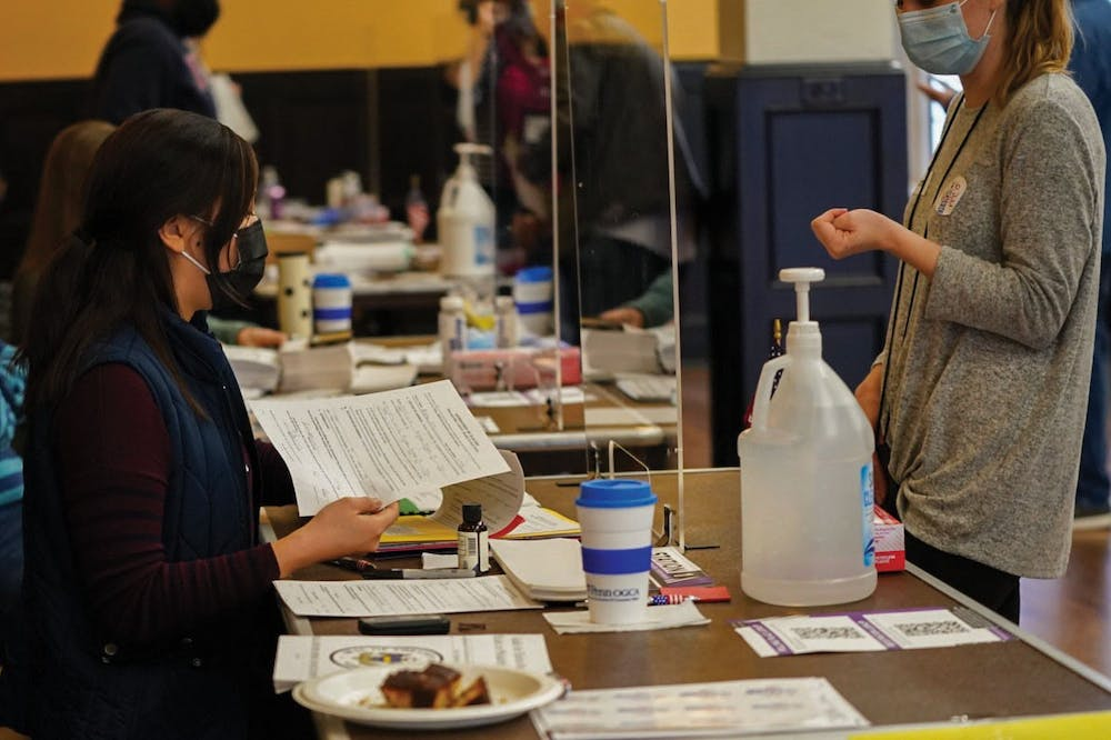 inside-the-polls-stickers-and-sanitizer-covid-19-election-day-houston-hall-hand-sanitizer