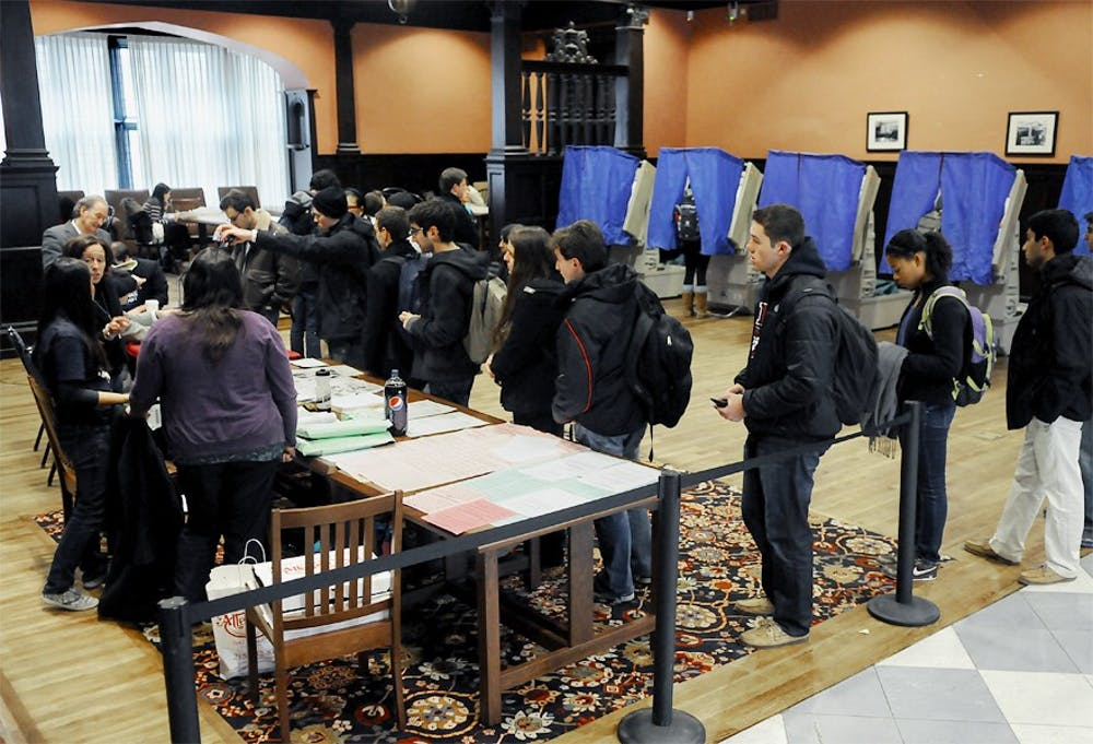 Photographs of students casting their votes in Houston Hall and Hill.