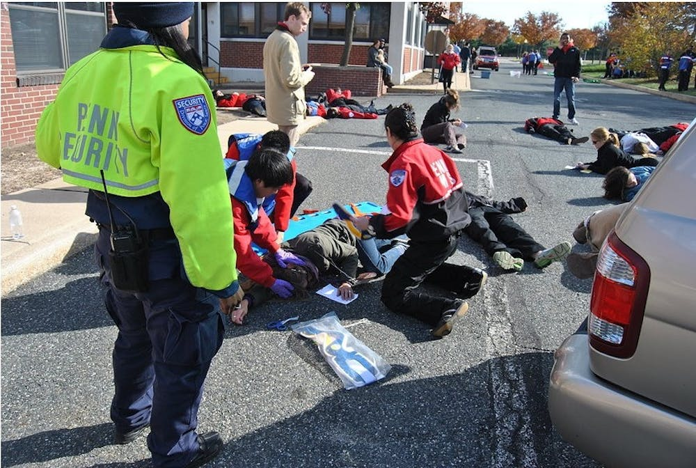 "Members of Penn's Medical Emergency Response Team attended to about 65 ""victims"" at a simulated chemical spill for their 4th Mass Casualty Incident Drill. The team cleared the simulation hour in about 30 minutes, improving on last year's time"