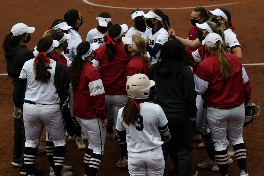 4-21-21-softball-vs-drexel-penn-team-mask-huddle-suhkmani-kaur