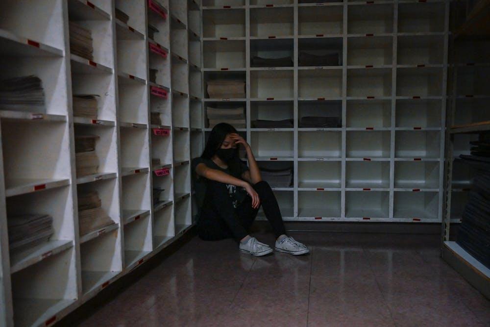 03-17-21-stressed-student-covid-19-masks-photo-illustration-ana-glassman
