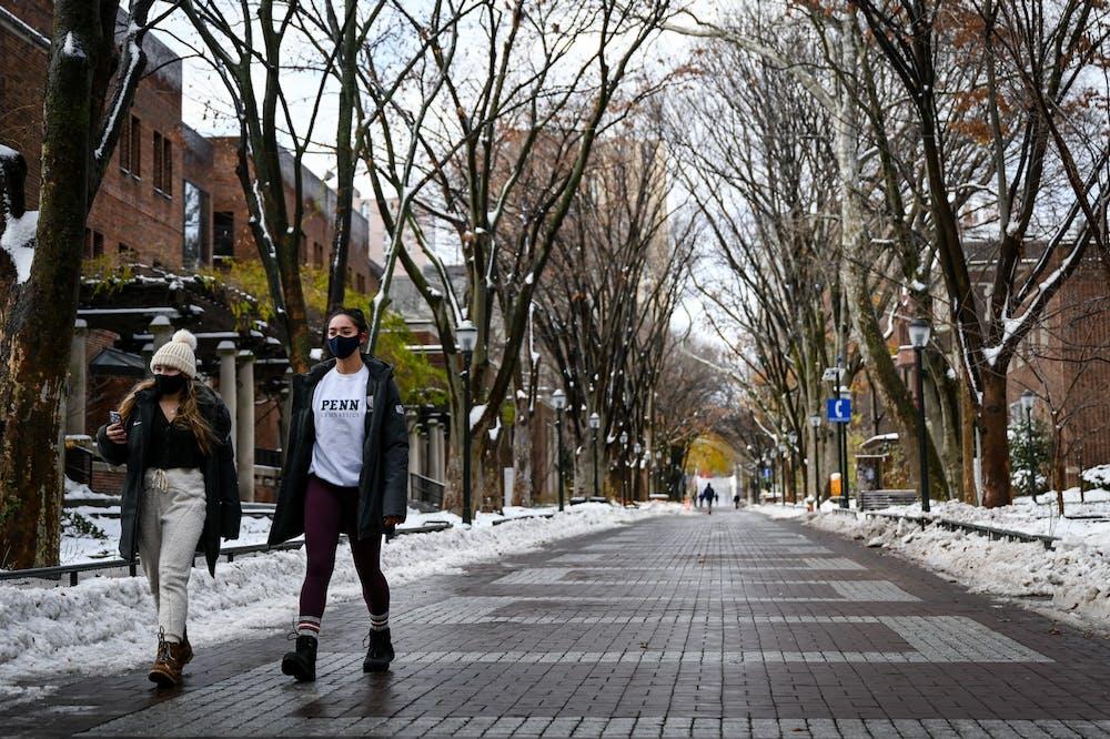 snow-winter-campus-locust-walk-students-covid-19-coronavirus-mask