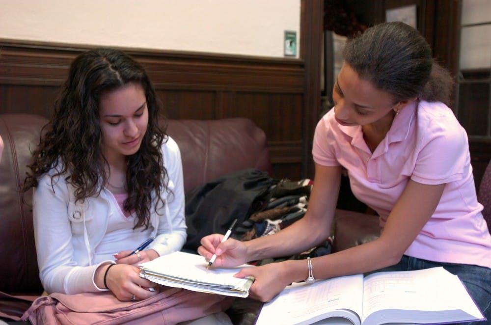 Angelina Benson tutors high school senior Vanessa Martinez in SAT Math.