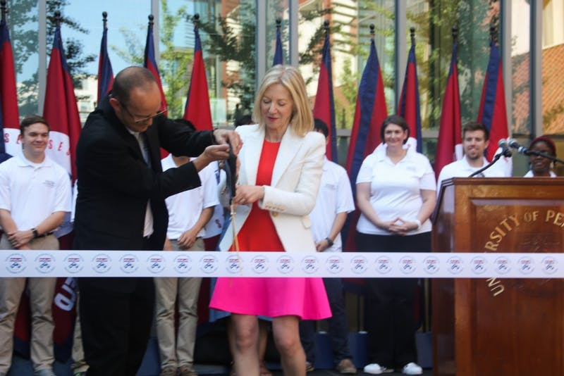 Photo gallery: Amy Gutmann cuts the ribbon at New College House