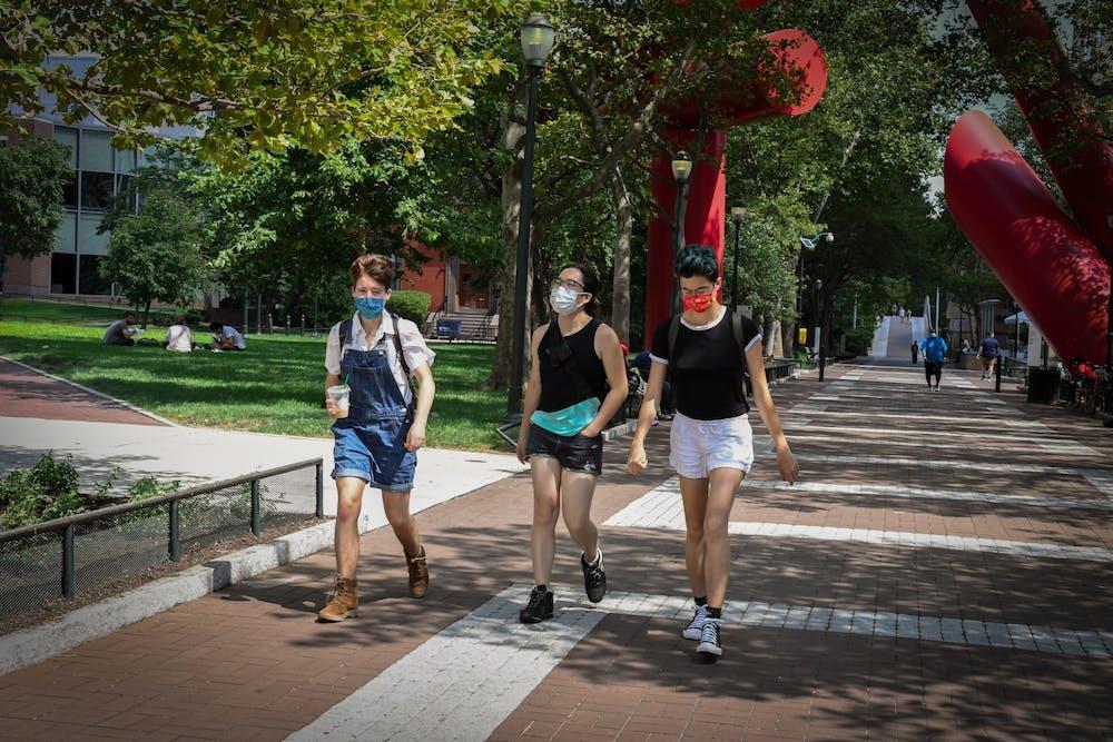 coronavirus-campus-people-in-mask-walk-tampons