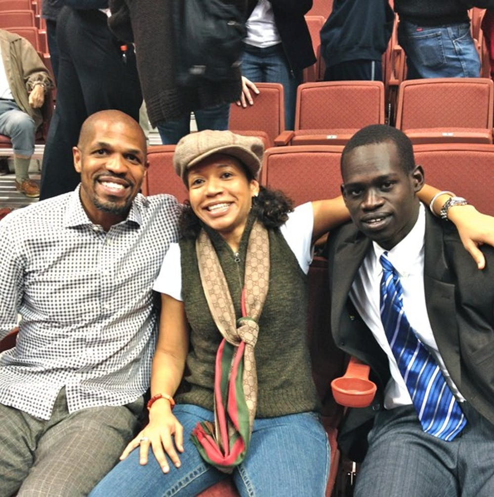 Over time, Dau Jok has become close with Penn graduate Kasia Muoto, (center) who started the We Play to Win foundation that promotes youth empowerment.